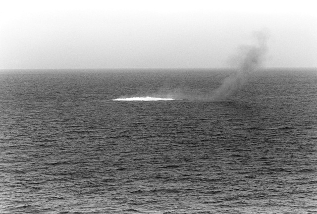 "Smoke and white water are all that is visible as the Panamanian ship ""SKY ONE,"" sinks completely below the surface. The tank landing ship USS SUMTER (LST 1181) and the amphibious assault ship USS INCHON (LPH 12) were utilized in the search and rescue of crewmen"