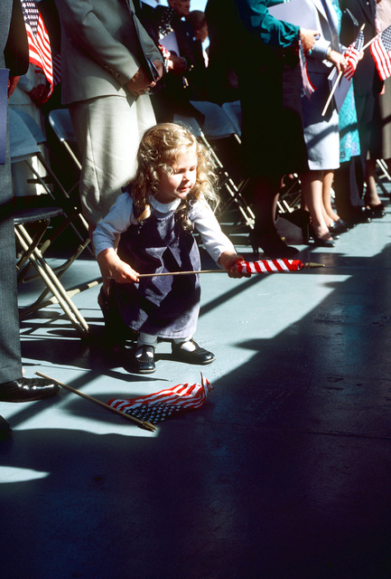 A young spectator with a miniature American flag attends the launching ceremony for the nuclear-powered aircraft carrier USS THEODORE ROOSEVELT (CVN 71) at Shipway 12 of the Newport News Shipbuilding shipyard