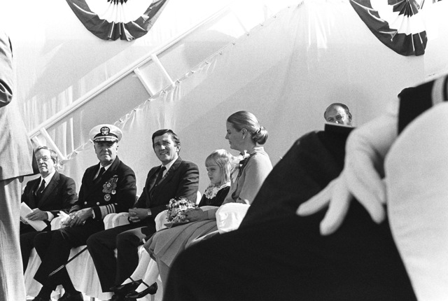 Attending the launching ceremony for the nuclear-powered aircraft carrier USS THEODORE ROOSEVELT (CVN 71) are, left to right, William Johnston, President of the Theodore Roosevelt Association; Admiral James D. Watkins, CHIEF of Naval Operations; Secretary of the Navy John F. Lehman Jr.; Lehman's daughter, Alexandra, Maid of Honor; and Lehman's wife, Barbara, Ship's Sponsor