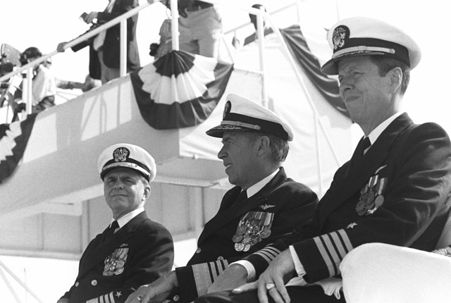 Attending the launching ceremony for the nuclear-powered aircraft carrier USS THEODORE ROOSEVELT (CVN 71) are, left to right, Admiral Kinnaird R. McKee, Director of the Naval Nuclear Propulsion Program; Admiral Wesley L. McDonald, Commander in CHIEF, Atlantic and Atlantic Fleet; and Captain Paul W. Parcells, prospective commanding officer of the carrier
