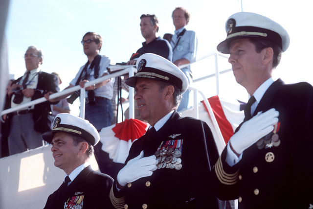 Attending the launching ceremony for the nuclear-powered aircraft carrier USS THEODORE ROOSEVELT (CVN 71) are, left to right, Admiral Kinnaird R. McKee, Director of the Naval Nuclear Propulsion Program; Admiral Wesley L. McDonald, Commander in CHIEF Atlantic and Atlantic Fleet; and Captain Paul W. Parcells, prospective commanding officer of the carrier