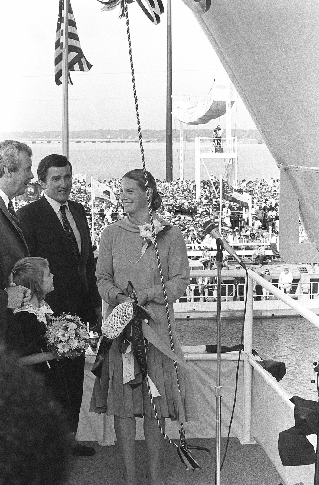 Barbara W. Lehman, wife of Secretary of the Navy John F. Lehman Jr. and Ship's Sponsor; prepares to christen the nuclear-powered aircraft carrier USS THEODORE ROOSEVELT (CVN 71) duringthe ship's launching ceremony. With Mrs. Lehman are, left to right, Edward J. Campbell, Newport News Shipbuilding; Lehman's daughter, Alexandra, Maid of Honor; and Secretary Lehman
