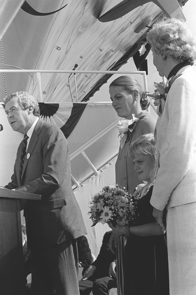 Edward J. Campbell, Newport News Shipbuilding, addresses guests at the launching ceremony for the aircraft carrier USS THEODORE ROOSEVELT (CVN 71). Behind Campbell at the podium are, left to right, Barbara W. Lehman, wife of Secretary of the Navy John F. Lehman Jr. and Ship's Sponsor; Lehman's daughter, Alexandra, Maid of Honor; and Mrs. William McMillan, Matron of Honor