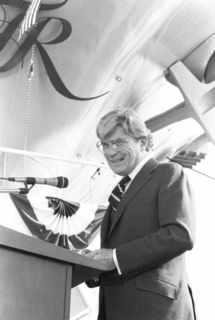 Senator John W. Warner, R-Virginia, addresses guests attending the launching ceremony for the nuclear-powered aircraft carrier USS THEODORE ROOSEVELT (CVN 71)