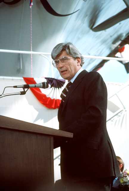 Senator John W. Warner, Republican-Virginia, addresses guests attending the launching ceremony for the nuclear-powered aircraft carrier USS THEODORE ROOSEVELT (CVN 71). The ceremony is taking place at Shipway 12 of the Newport News Shipbuilding shipyard
