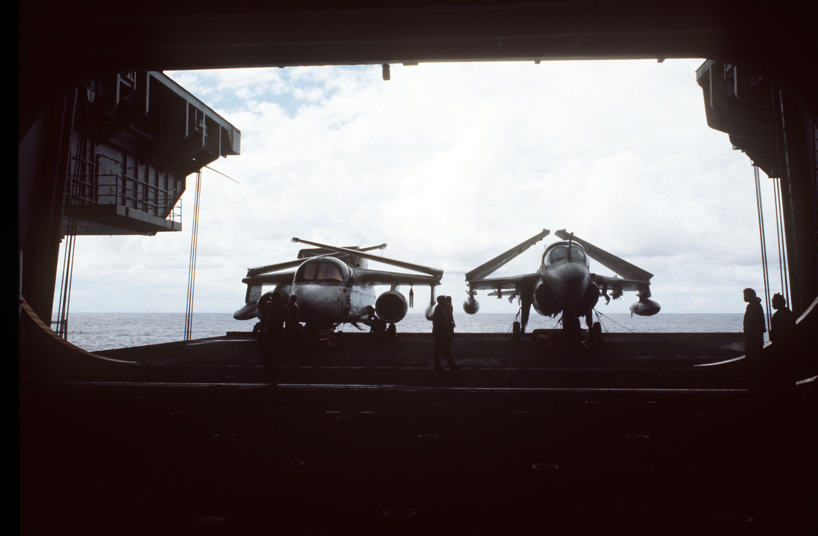 An S-3A Viking aircraft (left) and A-6E Intruder aircraft are parked on a lowered elevator aboard the aircraft carrier USS CONSTELLATION (CV 64) during Fleet Exercise 85