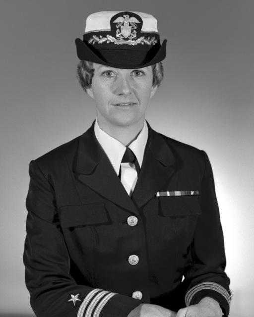 Commander Sandra L. Christensen, USN (covered)
