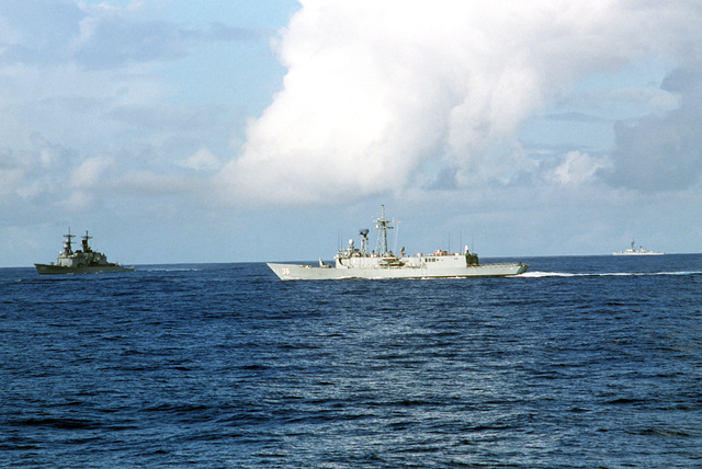 A port beam view of the guided missile frigate USS UNDERWOOD (FFG 36) underway during COMTUEX '85. The guided missile destroyer USS KIDD (DDG 993) is visible on the left Visible in the background is a Charles F. Adams class guided missile destroyer