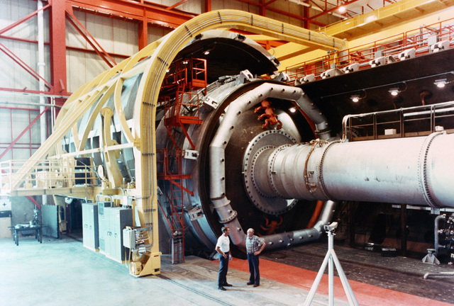 The Aeropropulsion test cell C-2 shown open with an engine simulator installed. The cell is 28 feet in diameter, 85 feet long, and is designed to accommodate full-scale engines mounted in portions of the airframe that would affect airflow during the flight