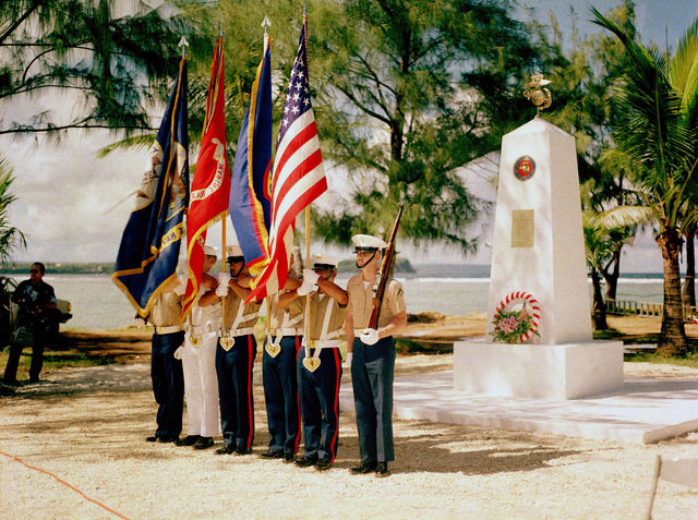 A joint Marine Corps/Navy color guard stands at attention at the Congressional Medal of Honor Monument dedication ceremony. The monument honors four Marines for heroism during World War II. They are Captain Louis Wilson, Jr., Private First Class (PFC) Leonard Mason, PFC Luther Skaggs and PFC Frank Witek