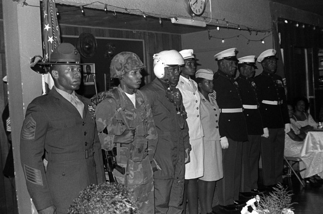 Black Marines participate in the Monfort Point Marine Association (MPMA) Marine Corps birthday ball. Present are (left to right) Sergeant Major (SGM) M. Allen; Sergeant (SGT) R. Holt; STAFF Sergeant (SSGT) C. Hughes; Captain (CPT) D. Woodard; Lance Corporal (LCPL) L. Sherrell; GUNNERY Sergeant (GYSGT) C. Bryant (ret.); 1ST Sergeant (1SGT) B. Person (ret.) and SGM J. McCary