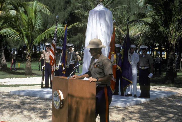 Marine Corps Colonel J. Karl Miller, commander, Marine Barracks Guam, speaks at the Congressional Medal of Honor Monument dedication ceremony. The monument was erected to honor four Marines for their heroism during World War II. They are Captain Louis Wilson Jr., Private First Class (PFC) Leonard Mason, PFC Luther Skaggs and PFC Frank Witek