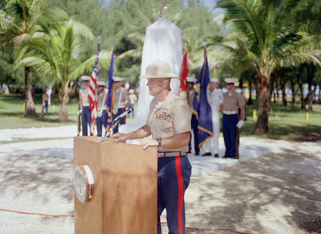 Marine Corps Colonel J. Karl Miller, commander Marine Barracks Guam, speaks at the Congressional Medal of Honor Monument dedication ceremony. The monument was erected to honor four Marines for heroism during World War II. They are Captain Louis Wilson, Jr., Private First Class (PFC) Leonard Mason, PFC Luther Skaggs and PFC Frank Witek