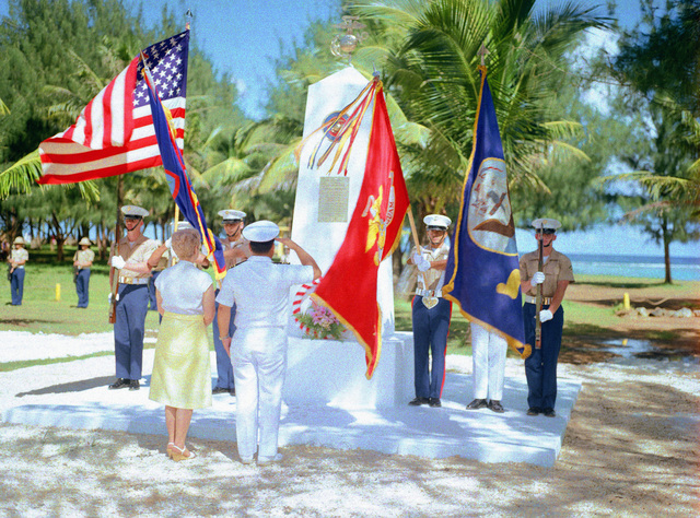 Mrs. Jean Witek, left, participates in a wreath of Honor Monument dedication ceremony. The monument was erected to honor four Marines for heroism during World War II. They are Captain Louis Wilson, Jr., Private First Class (PFC) Leonard Mason, PFC Luther Skaggs and PFC Frank Witek. (Substandard image)