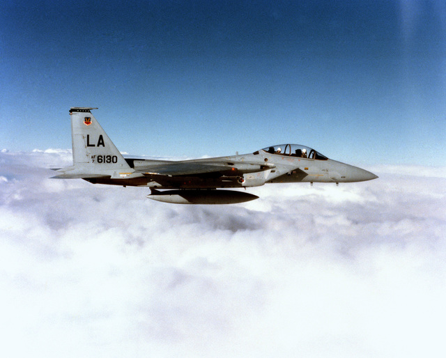 An air-to-air right side view of an F-15B Eagle aircraft from the 405th Tactical Training Wing, Luke Air Force Base, Arizona