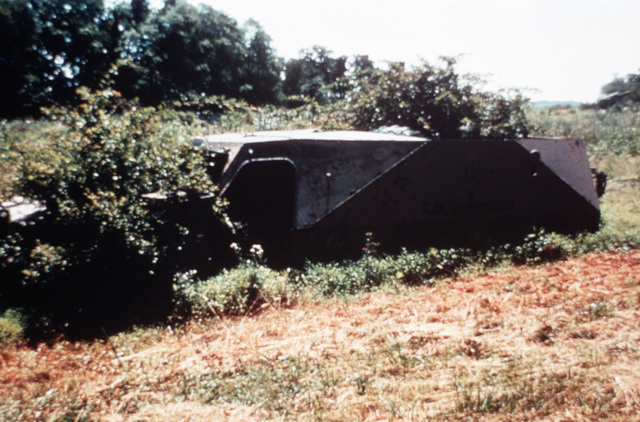 Left side view of a Soviet-built BTR-152V2 armored personnel carrier in a camouflaged position. (Substandard image)