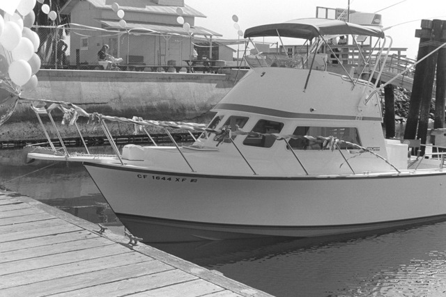 """A port bow view of the """"Soldier of the Sea"""", in dock by the boathouse at the Marine Corps Recruit Depot. The fishing boat, acquired by Special Services for use by active duty military personnel, was christened recently by Miss San Diego, Tracie Alexander"""