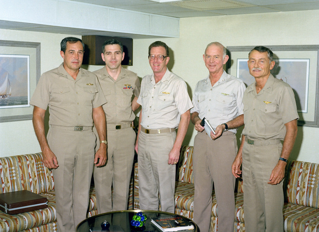 Pacific Fleet commanders attend a meeting for FLEET EXERCISE '84 aboard the nuclear-powered aircraft carrier USS CARL VINSON (CVN 70). From left to right are: Rear Admiral Walter T. Piotti Jr., commander, Cruiser Destroyer Group Five; Rear Admiral Jonathan T. Howe, commander, Cruiser Destroyer Group Three; Vice Admiral James R. Hogg, commander, Seventh Fleet, Rear Admiral Paul F. McCarthy Jr., commander, Battle Force Carrier Group Five; and Rear Admiral John R. Batzler, commander, Carrier Group Three