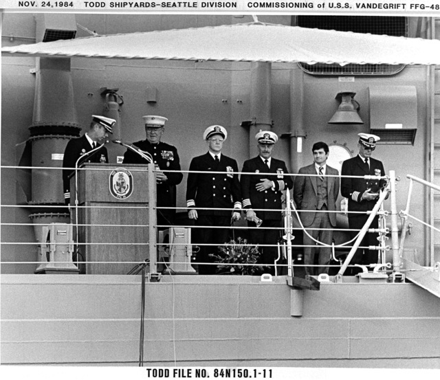 Distinguished guests attend the commissioning of the guided missile frigate USS VANDEGRIFT (FFG 48).  From left to right they are:  Commander Clinton (CDR) Clinton James Coneway, ship's commanding officer; Major General (MGEN) Earnest C. Cheatham Jr., commanding general, 1ST Marine Division; Rear Admiral L.S. Severance, commander, Naval Base Seattle; Captain Howard Venezia, commander, Surface Squadron One; John T. Gilbride Jr., general manager, Todd Pacific Shipyards Corp.; and Chaplain (CAPT) Joseph Brennan
