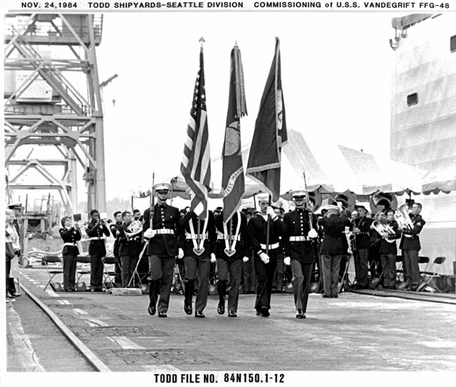 The 1ST Marine Division color guard and the 1ST Marine Division Band from Camp Pendleton, California, march during the commissioning of the guided missile frigate USS VANDEGRIFT (FFG 48)