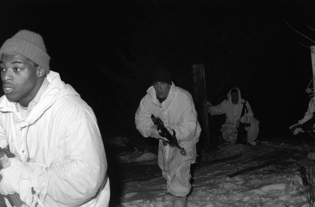 Members of the recruiting pool move toward their objective during a cold-weather exercise. The recruiting pool is made up of individuals in the delayed enlisted program who have not yet reported to basic training