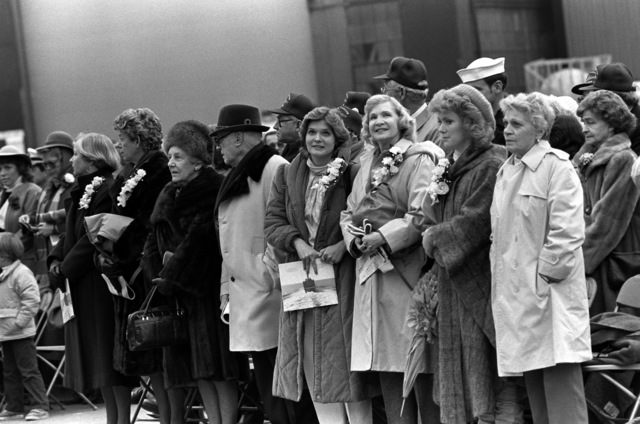 Left to right: Mrs. W.E. Haggett, Mrs. Lee Baggett Jr., Mrs. J.P. Fitzgerald, retired Rear Admiral J.P. Fitzgerald, Diane Taylor Oeland, Barbara A. Taylor, Mrs. E.C. Webster and Gwynne Taylor Church attend the commissioning ceremony for the guided missile frigate USS TAYLOR (FFG 50) at Bath Iron Works Corp