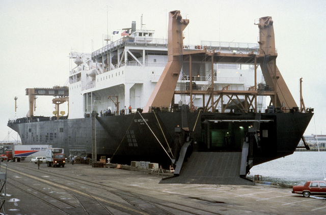 A port quarter view of the Waterman class maritime prepositioning ship SS SGT MATEJ KOCAK (T-AK 3005) with its stern ramp deployed. The ship will be loaded with equipment of the 6th Marine Amphibious Brigade