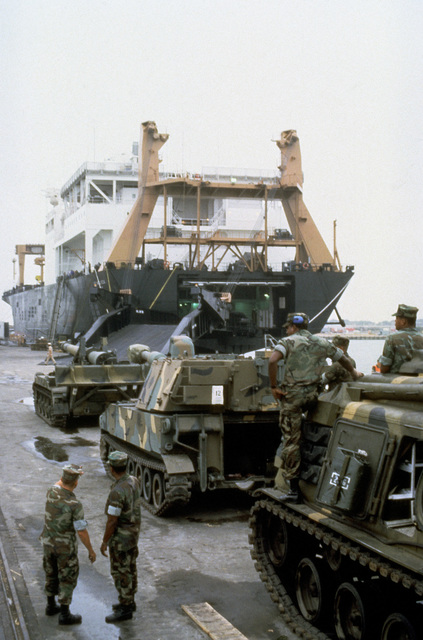 Armor and artillery of the 6th Marine Amphibious Brigade is staged on the pier prior to being loaded aboard the Waterman class maritime prepositioning ship SS SGT MATEJ KOCAK (T-AK 3005). From front to back: an M881A1 armored recovery vehicle, an M109A2 155 mm self-propelled howitzer and an M110A2 203 mm self-propelled howitzer
