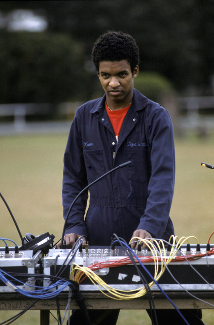 Audio director AIRMAN First Class (A1C) Keenan Carter operates the sound board during a sound check for the Top in Blue show. The group includes Air Force personnel who entertain Air Force members and their families around the world