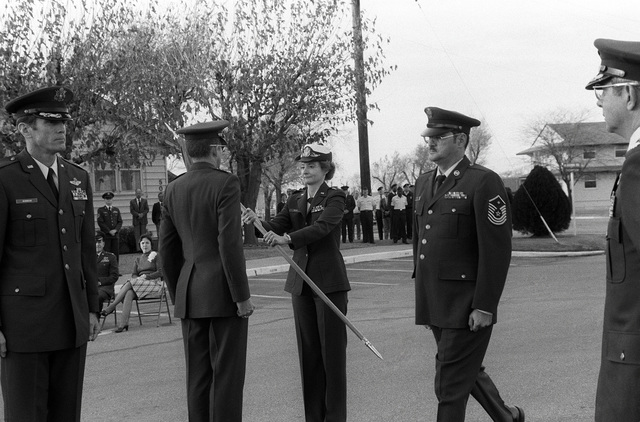 Lieutenant Colonel (LTC) Mary Felts turns over command of the 71st Air Base Group to LTC Danny J. Parnell during a change of command ceremony. Standing in the foreground is Colonel (COL) Ellwood Parke Hinman, commander, 71st Flying Training Wing