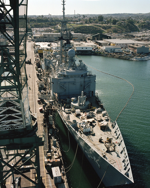 Elevated starboard bow view of the Oliver Hazard Perry class guided missile frigate USS FORD (FFG 54) under construction at Todd Pacific Shipyards. The ship is 80 percent complete