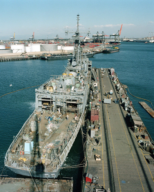 Elevated starboard quarter view of the Oliver Hazard Perry class guided missile frigate USS FORD (FFG 54) under construction at Todd Pacific Shipyards. The ship is 80 percent complete