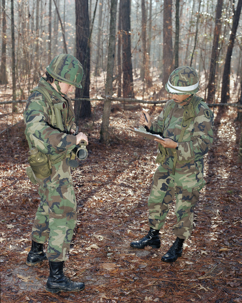 STAFF Sergeant (SSG) Adolberto Q. Rosado, Company C, 4th Battalion, Aviation Training Brigade (right), explains the methods of extension of the M72A2 light antitank weapon (LAW) to Private (PVT) Sunni Edmundson, Company A, 4th Battalion, Aviation Training Brigade