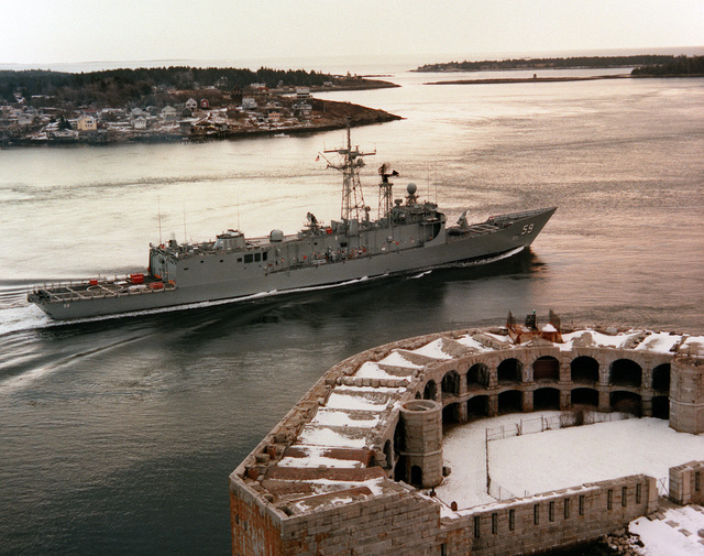 A starboard view of the guided missile frigate KAUFFMAN (FFG-59) as it passes an old fort on the Kennebec river while en route to sea trials
