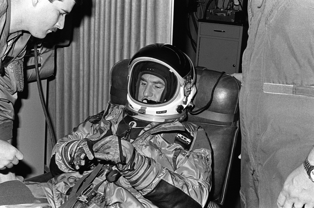 "Captain William D. Stanford helps Craig Nelson with the controls on his space suit. Nelson, who portrays Colonel Sarnac on the TV series ""Call to Glory, and a film crew are preparing to shoot episodes depict the early SR-71 Blackbird flights"