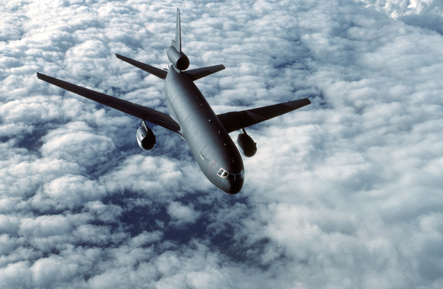 An air to air front view of a camouflaged KC-10A Extender aircraft from the 22nd Air Refueling Wing