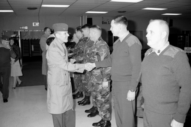 Lieutenant General George B. Crist, left, exchanges greetings with Lieutenant Colonel (LTC) McComb, executive officer, MCAS Iwakuni, upon his arrival for a tour of the base. (SUBSTANDARD)