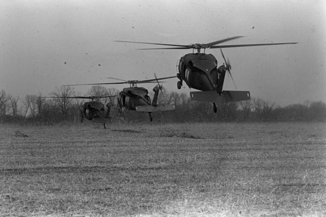 US Army UH-60 Black Hawk (Blackhawk) helicopters lift off from a landing zone after dropping off Marine reservists of Company 1, 3rd Battalion, 24th Marines, 4th Marine Division, during a weekend drill
