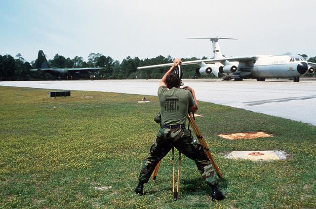 Sergeant (SGT) Rick Trinque, Detachment Seven, 1361st Audiovisual Squadron, films a C-141B Starlifter transport aircraft during Operation BIG SQUIRT