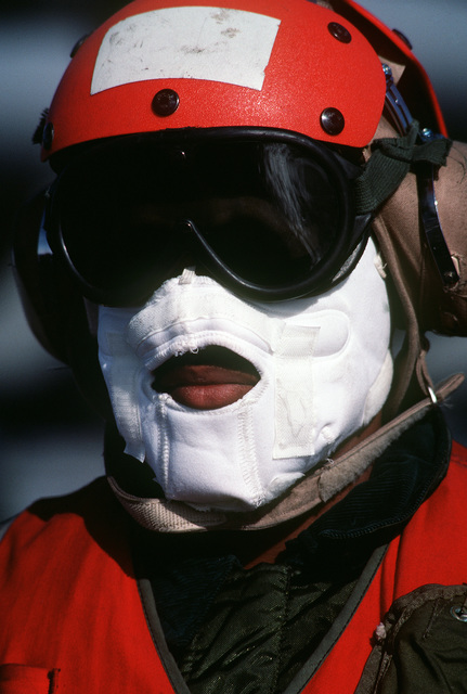A flight deck crewman participating in Exercise OCEAN SAFARI '85 wears a face mask for protection against the cold