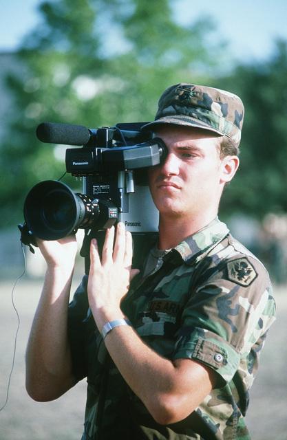 An infantryman aims an M60 machine gun during Exercise REFORGER '85