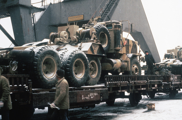 An M911 truck tractor on a flatbed railroad car during Exercise REFORGER'85