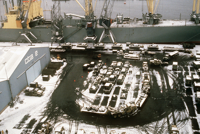 Tanks and military vehicles are offloaded from the vehicle cargo ship SS ADM. WM. M. CALLAGHAN (T-AKR 1001) during Exercise REFORGER'85