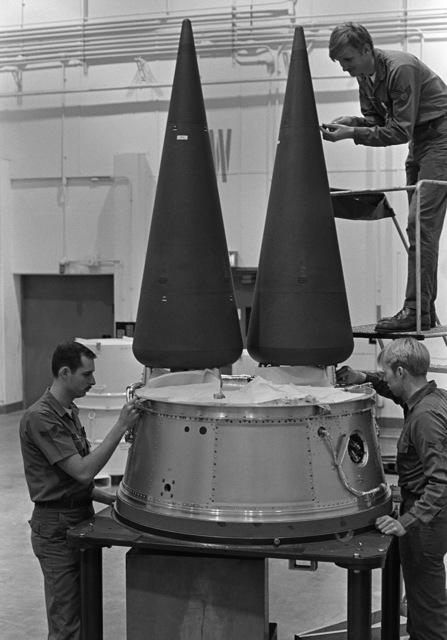 Technicians work on the warheads of an LGM-30G Minuteman III intercontinental ballistic missile