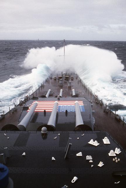 The bow of the battleship USS IOWA (BB 61) crashes through heavy seas during Exercise OCEAN SAFARI '85