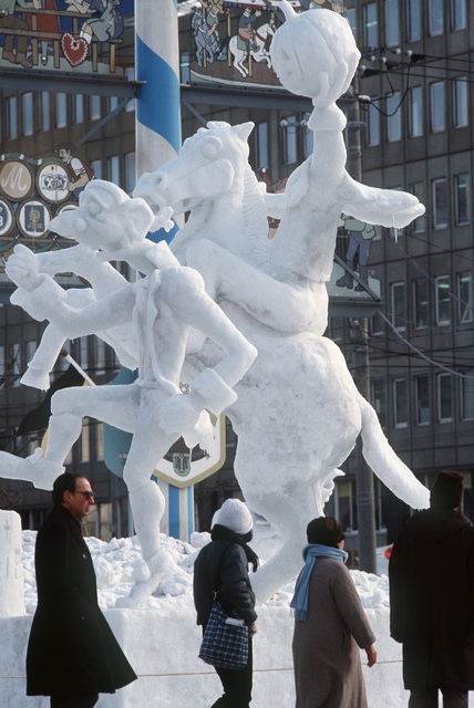 "Japanese tourists admire the finished sculpture of the 1985 US Olympic Snow Sculpting Team, Yokota Air Base, Japan: ""Icabod Crane and the Headless Horseman,"" during the 12th International Snow Statue Contest"