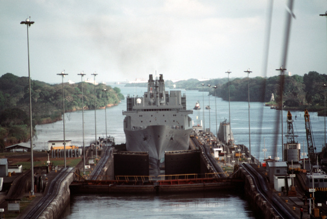 A bow view of the Military Sealift Command Algol class vehicle transport ship USNS BELLATRIX (T-AKR 288) entering the lower chamber, west side, of the Gatun Locks in its transit from the Atlantic to the Pacific