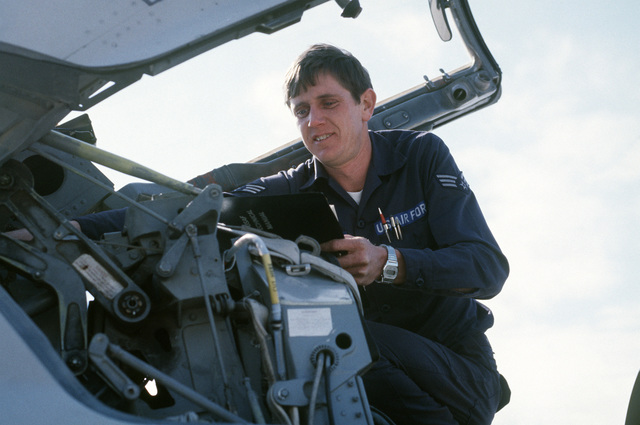 Sergeant (SGT) James L. Thomspon, aircraft maintenance technician assigned to the 56th Engineering Maintenance Squadron, makes a routine inspection of an ejection seat