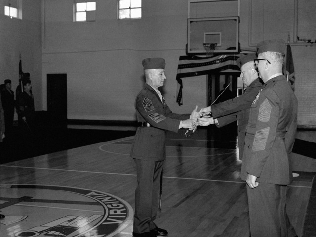 Sergeant Major (SGM) Irrerra accepts command as sergeant major of the Fleet Marine Force, Atlantic, from Lieutenant General (LGEN) D'Wayne Gray, chief of staff, Headquarters, Marine Corps