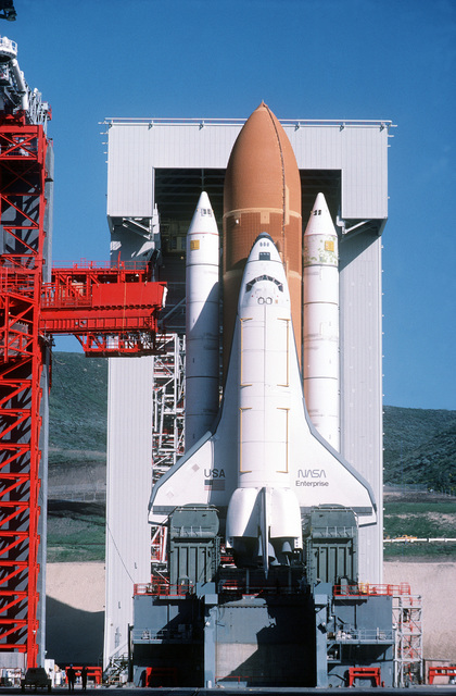 """Close-up view of Space Shuttle Enterprise in launch position on the Space Launch Complex (SLC) #6, commonly known as """"SLICK 6"""", during the ready-to-launch checks to verify launch procedures. Exact Date Shot Unknown"""